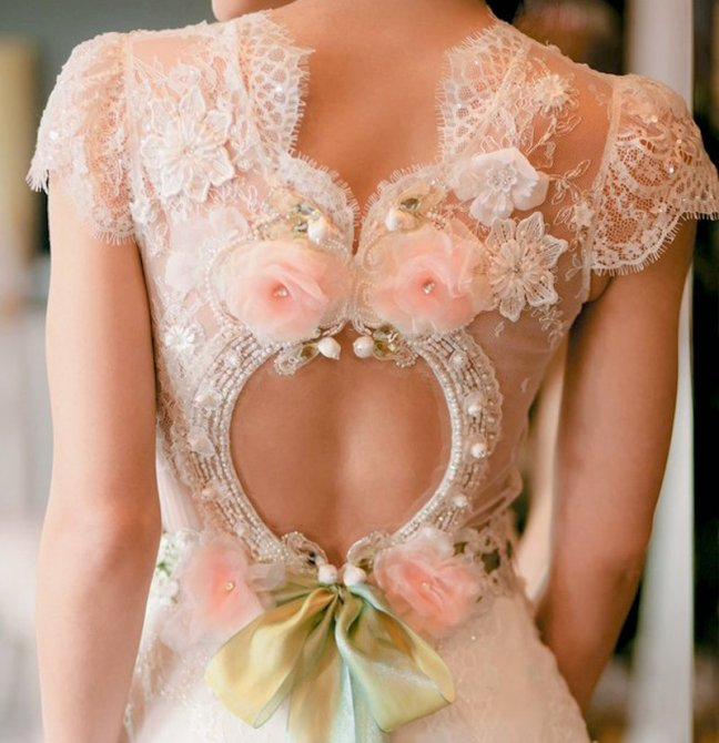 The romantic ribbon that ties gracefully. The pearls and beads in a circular backsuggests eternity as well as beauty. Breath-taking!