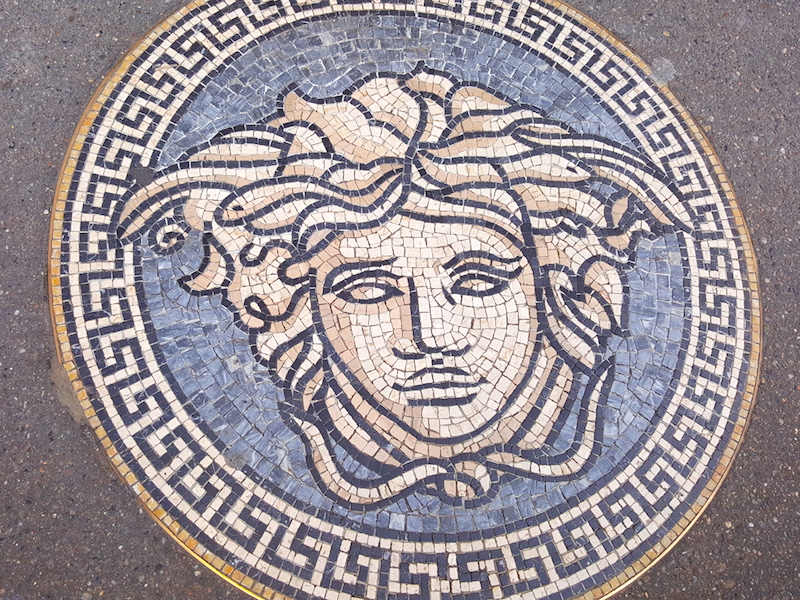 Even the sidewalks are fancy with the Versace Mosaic motif in a round medallion.Medusa!!